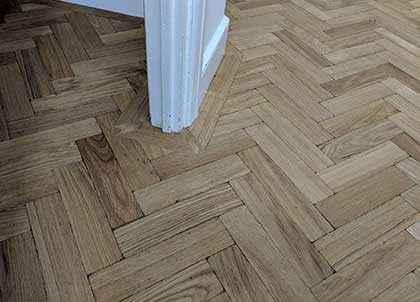 Aged parquet blocks.  The border mirrors the design of the architraves for a professional fit