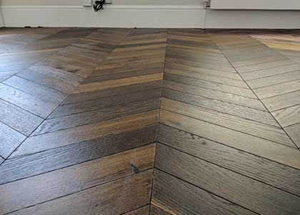 The straight orderly lines of a chevron wooden floor
