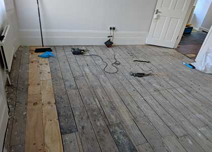 The uneven floor with original pine floorboards