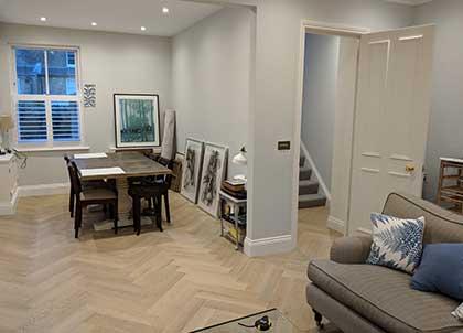 The Herringbone parquet design runs into the dining room