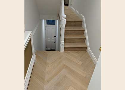 The point of the Herringbone pattern matches on each landing