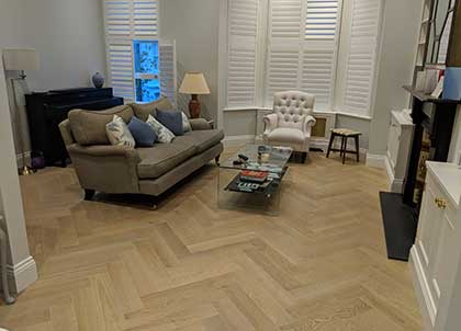 Coastal grey parquet wood flooring in the living room