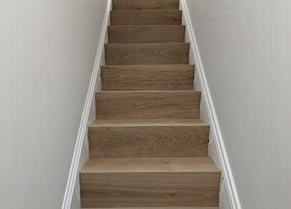 Transformed stairs with oak cladding