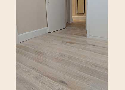 New white oak wooden flooring in one of the bedrooms