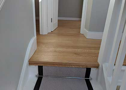 Nosing creates a clean edge between the wood floor and runner