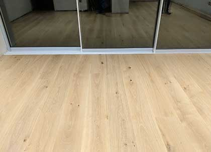 After, the new wooden floor on a level floor, fitted tightly to the doors