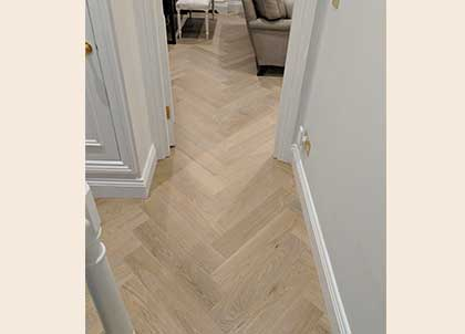 Herringbone pattern running seamlessly from the living room to hall