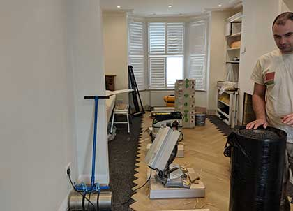 Herringbone Oak Parquet fitted on top of the acoustic underlay