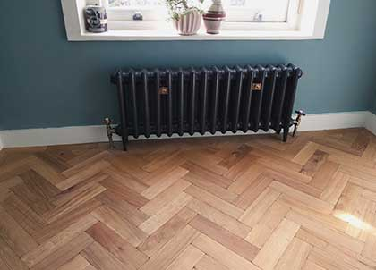The classic Herringbone design of a parquet block wooden floor