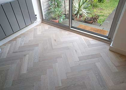 Pale parquet flooring will brighten a room and is great for achieving a Scandi look