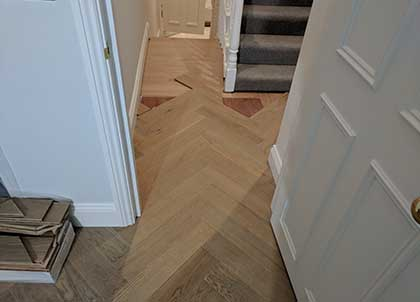 The Parquet continues into the hall