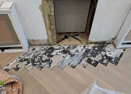 The damaged parquet is removed