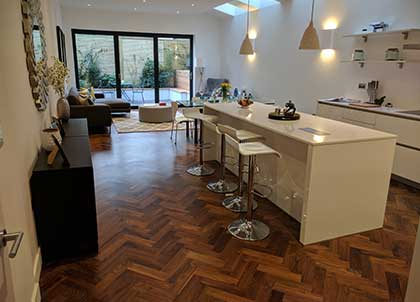 We fitted this walnut parquet throughout this home
