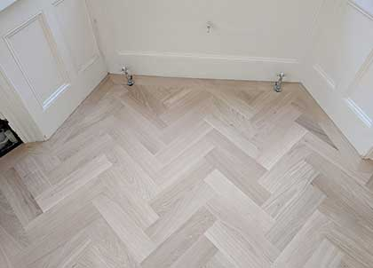 Unsealed Oak Parquet fitted on top of soundproofing