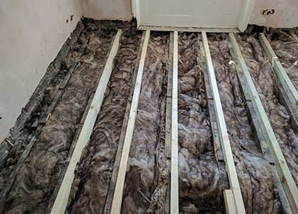 Acoustic wool sits between the joists