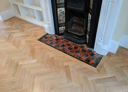 Wider border fitted around one of the fireplaces