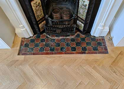Fireplace with a wide oak border