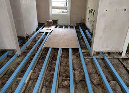 The blue joist caps sit on top of the joists
