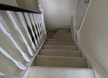 The staircase with the old beige carpet