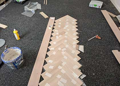 The parquet wooden floor is fitted on top of the membrane