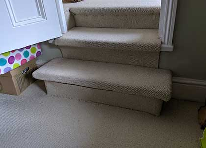 The uneven steps were covered in carpet