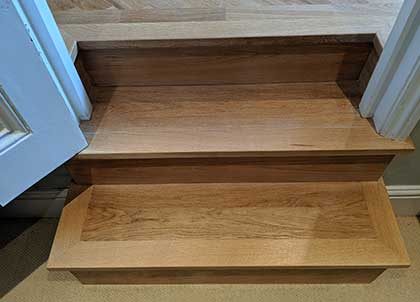 The steps restored and clad in smart oak