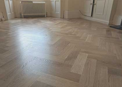 The end result, sealed oak parquet fitted in a Herringbone pattern