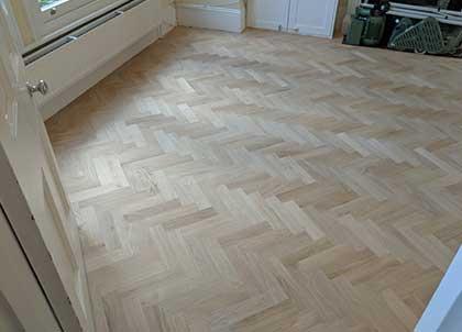 The untreated oak parquet wooden floor