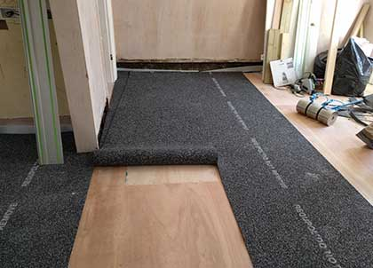 Membrane being fitted on top of plywood