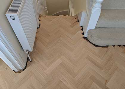 The small entrance hall with the new oak parquet floor