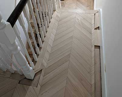 We laid the chevron parquet first and then filled in the single row border
