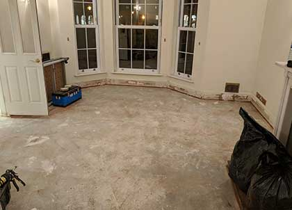 The exposed subfloor in the main living room