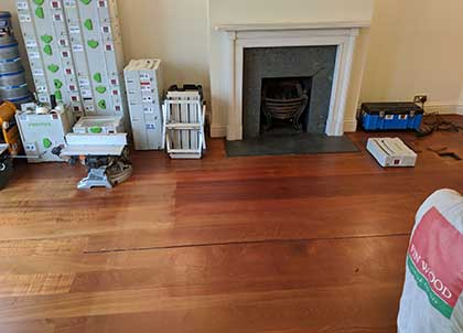 The jatoba floor is discoloured and features large gaps between the boards