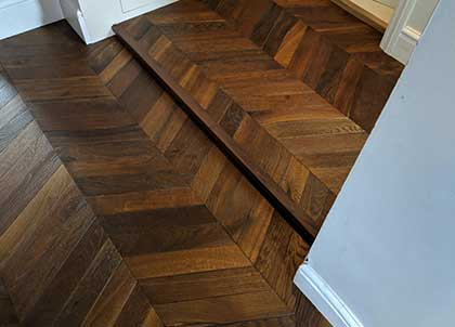 A small step was incorporated into this chevron floor to allow for the variation in floor levels