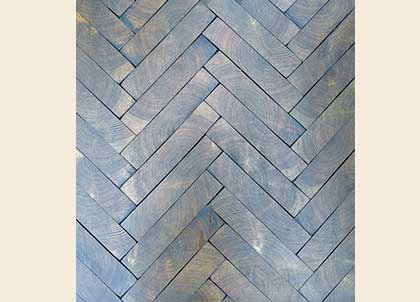 Premier end grain parquet with gaps between the blocks, finished in a dark oil