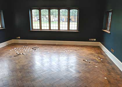 Before shot - this parquet floor had loose blocks and the surface was dirty and dull