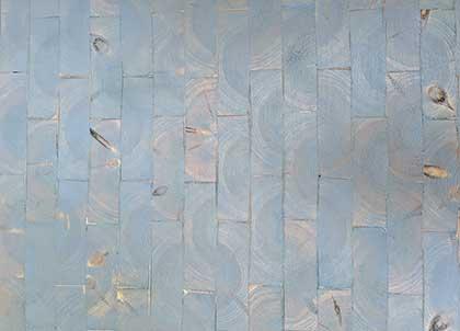 Grey tones in a parquet end grain floor laid in a brick design