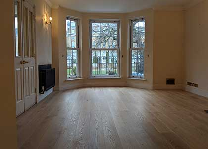 The newly installed oak wooden floor