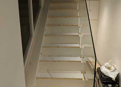 We cut a section out of the stairs to allow for the new treads.