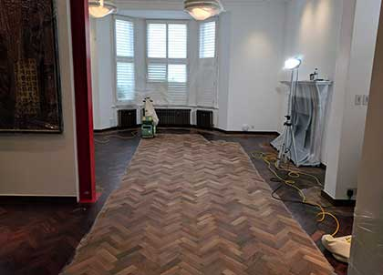 This solid wood parquet floor was sanded to remove the old lacquer