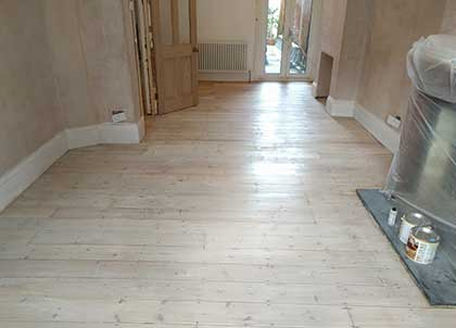 This pine floor has been sealed with a white oil, so you still seen the knots and grain of the wood