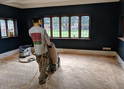 This solid wood parquet floor needed to be completely stripped back to the bare wood