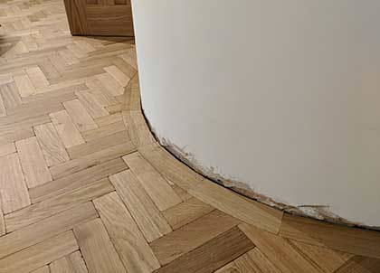 The parquet design mirrors the shape of the wall