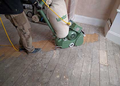 Sanding will remove dirt, but some marks may be ingrained in the wood