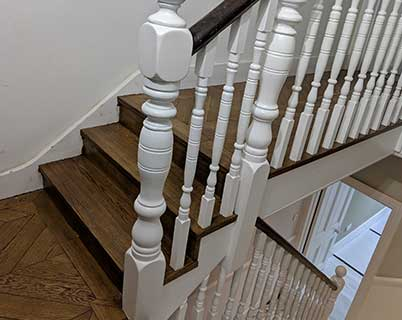 The stairs have been clad in matching oak with the oak sitting under the spindles