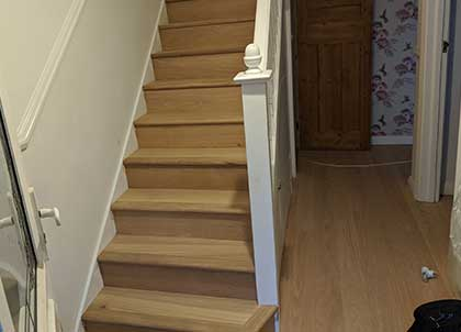 The stairs clad in the new oak