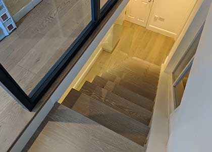 After our work, the oak links the two floors together