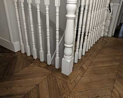 The floor fits neatly under the stair spindles