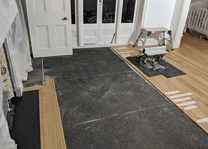 The new oak boards sit on the Impact Sound Reduction Membrane