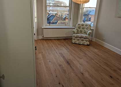 The wooden floor and original skirting boards